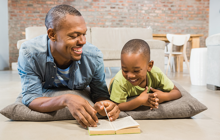 african-american-father-reading-to-his-son